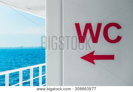 Sea Cruise On Boat, Wc Pointing Arrow. Feeling Unwell In A Sea, Looking For Toilet, Concept.