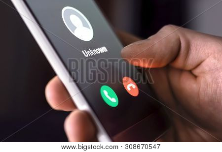 Phone Call From Unknown Number Late At Night. Scam, Fraud Or Phishing With Smartphone Concept. Prank