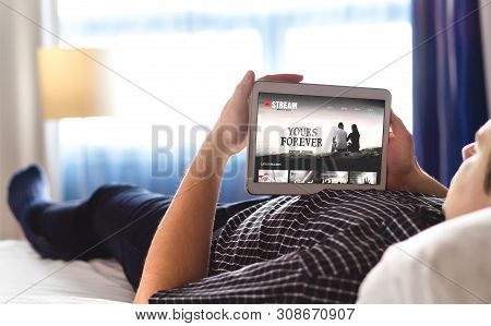 Movie, Video And Online Streaming Service In Tablet. Man Choosing And Watching Digital Film With Sma