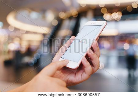 Chiang Mai, Thailand - May.10,2019: Woman Holding Apple Iphone 6s Rose Gold With Google Apps On Scre