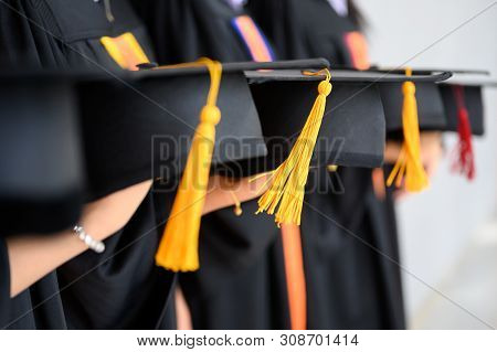 The Graduating Student Group Wore A Black Hat, Black Hat, At The Graduation Ceremony At The Universi