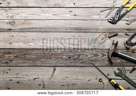 Flat Lay Composition With Vintage Carpentry Tools On Rough Wooden Background. Top View Workbench Wit