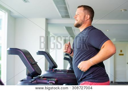 Chubby Man Walking On Running Track, Warming Up On Gym Treadmill.