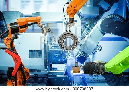 Industrial Robotic Welding And Robot Gripping Working On Smart Factory, On Machine Blue Tone Color B