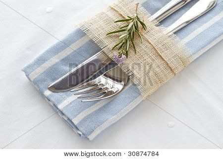 Knife And Fork With Napkin And Rosemary