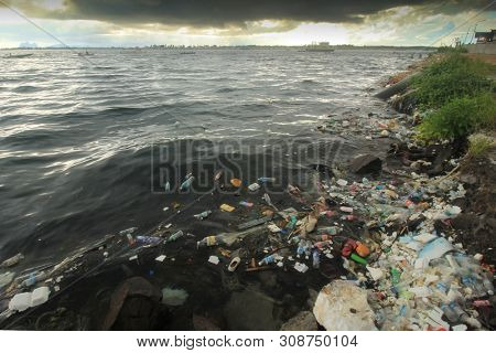 SEMPORNA, MALAYSIA - 24 JUNE 2019: Plastic pollution on beach and in sea