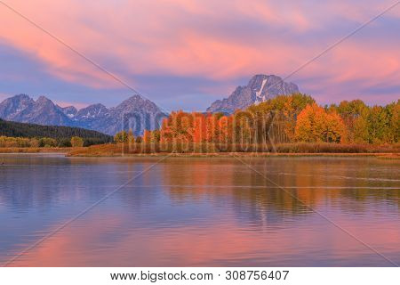 A Scenic Autumn Reflection Landscape Of The Tetons At Sunrise