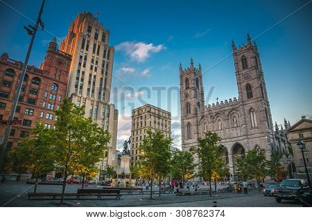 Quebec, Canada, July 2012 - Chomedey Square In Montreal City Dominated By The Basillica Of Notre-dam