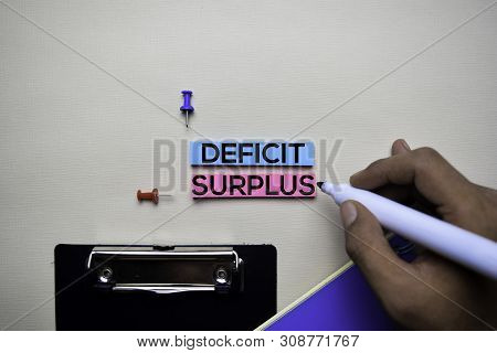 Deficit Or Surplus Text On Sticky Notes With Office Desk Concept