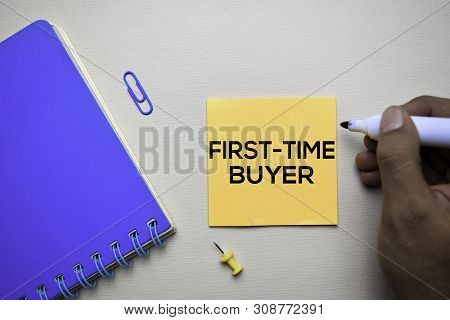 First Time Buyer Text On Sticky Notes With Office Desk Concept