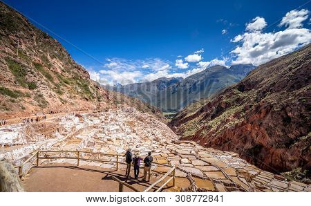 Visitors Viewing Salt Extraction Pans Salinas In Sacred Valley Of Incas, Peru