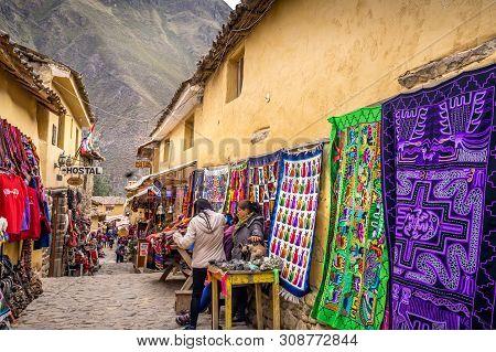 Cusco, Peru - May 1, 2019 - Cobblestone Walkway Of Chinchero Village, Locals In Sacred Valley Sellin