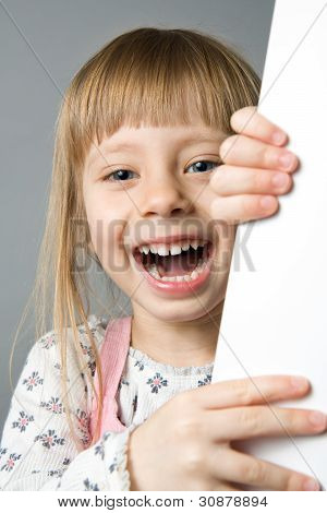Studio Portrait Of A Girl Laughing