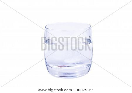 Aspirin Dissolving In The Glass Of Water