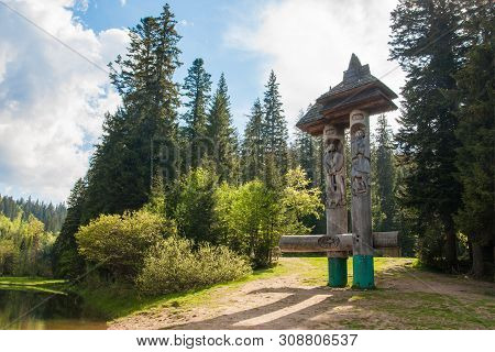 Synevyr, Ukraine - May 23, 2010: Wooden Monument At Synevyr Lake In Ukraine
