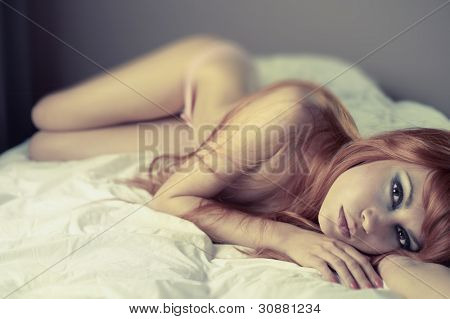 poster of Fashion portrait of young sensual woman in bed