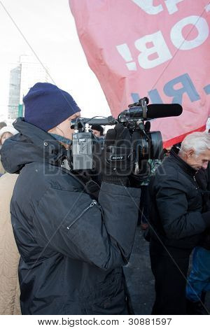 MOSCOW - MARCH 10: Operator shoots a film about the participants of the protest manifestation against falsification of the president election, Noviy Arbat in Moscow. March, 10, 2012 in Moscow
