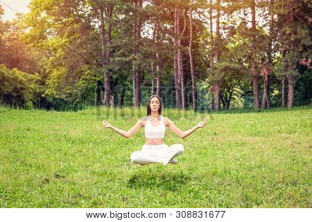 Young Woman In Yoga Meditation Levitation  Outdoor