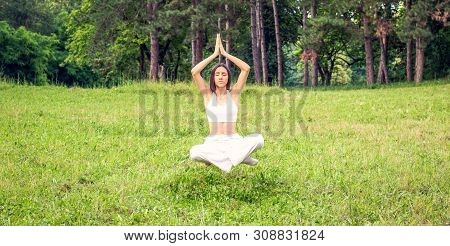 Young Woman Levitating In Yoga Position, Meditation Outdoor