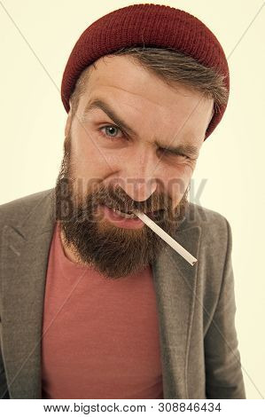 Brutal unshaven guy smoking isolated white background. Brutal habits and lifestyle of tramp. Hipster brutal bearded tobacco smoker. Man brutal bearded hipster dressed as vagabond smoking cigarette. poster