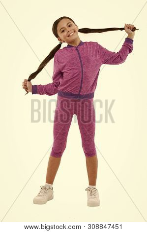 poster of Sport for girls. Guidance on working out with long hair. Deal with long hair while exercising. Working out with long hair. Girl cute kid with long ponytails wear sportive costume isolated on white.