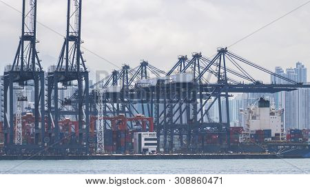 Industrial Port With Containers Ship In The Victoria Harbor At Hong Kong City