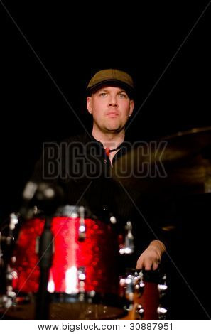 VANCOUVER, CANADA - FEBRUARY 9: jazz band Tambura Rasa. Trevor Grant (drums) on the stage of The Jazz Cellar on February 9, 2011 in Vancouver, Canada.