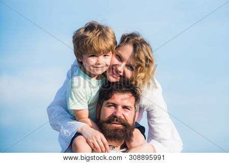 Dad Mom And Son. Dad Mom And His Child Son Are Playing On Sky Background. Happy Family. Family Holid
