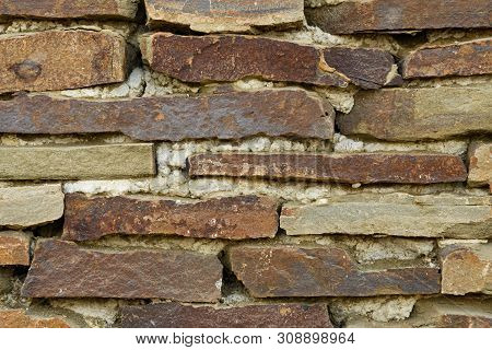 The Wall Is Made Of Large Stone Fragments Connected Directly To Each Other With The Help Of Concrete