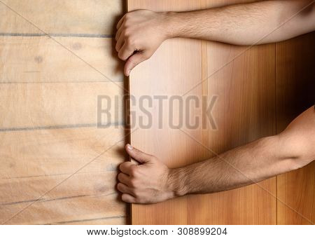 Male Hands Install Mdf Panels On The Prepared Wall
