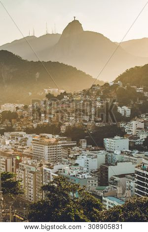 Sunset View In Copacabana, Apartment Buildings, Favela Babilonia, Mountains, And Corcovado