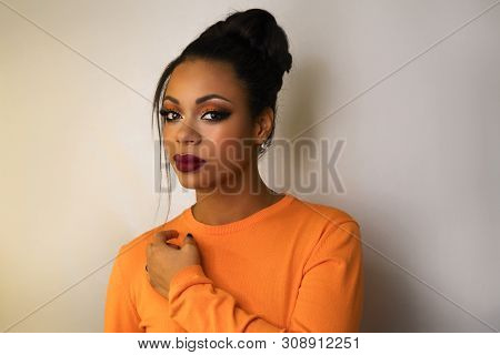 Portrait Of Attractive Afro American Young Woman With Fashion Luxury Makeup Orange-coloured Shades A