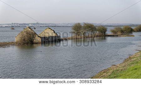 Spring Tide Flooded Grazing Marsh At Horsey Island, Braunton Marsh, Devon, Uk  Appledore In The Dist
