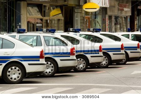 Police Patrol Automobiles On Streets