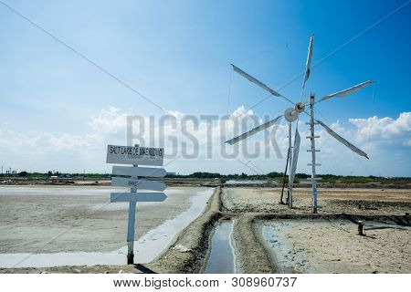 Blank White Wooden Guidepost On Salt Lake With Wind Propelled. Blank Wooden Sign Painted Using White