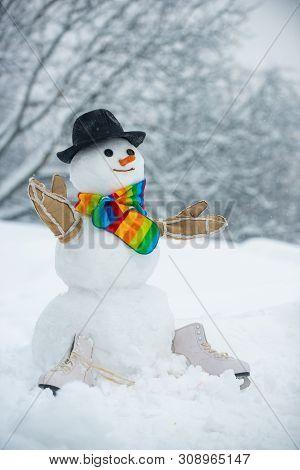 Cute Snowman In Hat And Scarf On Snowy Field. Funny Snowmen. Greeting Snowman. Snow Men. Snow Man In