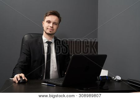 Front View Of Handsome Man In Black Smart Suit Posing While Working With Lie Detector. Young Male Si