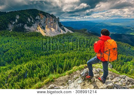 Cheerful Hiker Woman With Backpack, Enjoying The View In Mountains. Sporty Backpacker Hiker On The C