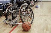 handicap basketball game with wheelchair indoor court poster