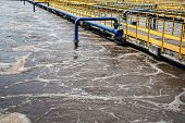Aeration tanks in sewage recycling and cleaning, modern wastewater treatment plant. poster