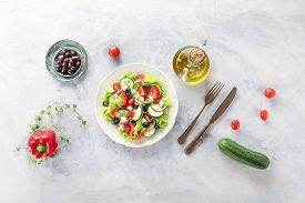 Greek Salad With Ingredients. A Plate Of Fresh Salad With Lettuce, Feta Cheese, Tomatoes, Cucumbers,