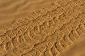 Background.  Car Tire Track On The Desert.