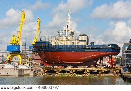 Newly Built Tugboat At The Shipyard.ready To Launch To The Water