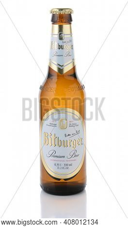 IRVINE, CA - JANUARY 11, 2015: A bottle of Bitburger Beer isolated on white. Bitburger is a German family business with around  that in 2012 produced around 750 million litres of beer.