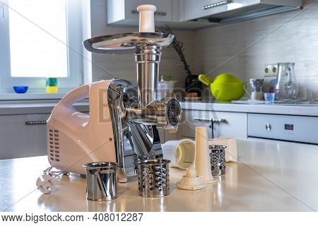 Electric White Meat Grinder. Minced Meat Is Wound And Lies In A Metal Bowl. Copy Space. Text