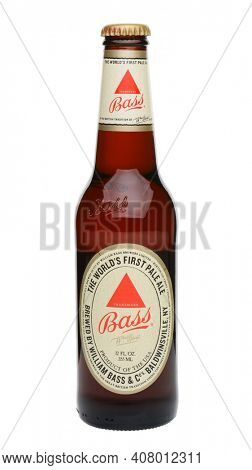 IRVINE, CA - MAY 27, 2014: A single bottle of Bass Pale Ale on white. The Bass Brewery founded in 1777 by William Bass, in Trent, England is now owned by Anheuser-Busch InBev.
