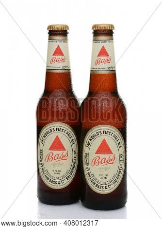 IRVINE, CA - MAY 25, 2014: Two bottles of Bass Ale with condensation. The Bass Brewery was founded in 1777 by William Bass, in Trent, England is now owned by Anheuser-Busch InBev.