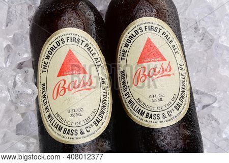IRVINE, CA - MAY 25, 2014: Two bottles of Bass Ale on a bed of ice. The Bass Brewery was founded in 1777 by William Bass, in Trent, England is now owned by Anheuser-Busch InBev.