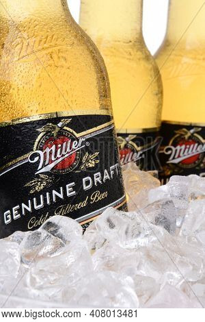 IRVINE, CA - MAY 30, 2014: Closeup of Miller Genuine Draft bottles in ice. MGD is actually made from the same recipe as Miller High Life except it is cold filtered.