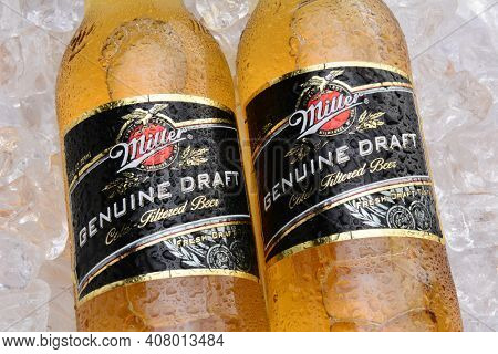 IRVINE, CA - MAY 27, 2014: Two Bottles of Miller Genuine Draft, on ice. MGD is actually made from the same recipe as Miller High Life except it is cold filtered.